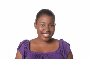 Studio portrait of young African American woman smiling on white background