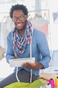 Handsome fashion designer using digital tablet