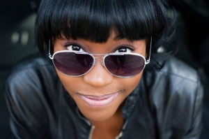 Close up portrait of young woman in sunglasses